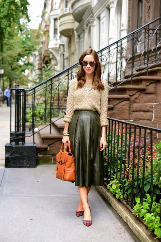 03-a-green-pleated-midi-leather-skirt-a-neutral-sweater-a-statement-necklace-and-plaid-heels