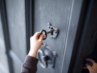 Child unlocking a door